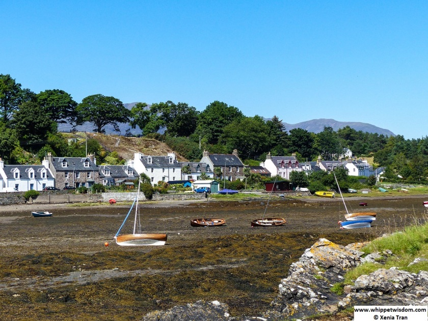 boats resting beside anchors at low tide in Plockton Bay