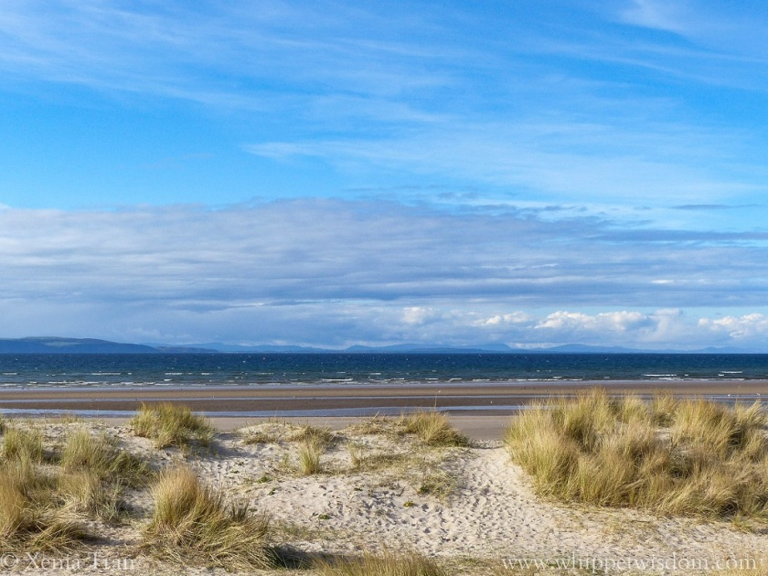 dunes, beach, sea and hills across the Moray Firth on a sunny day