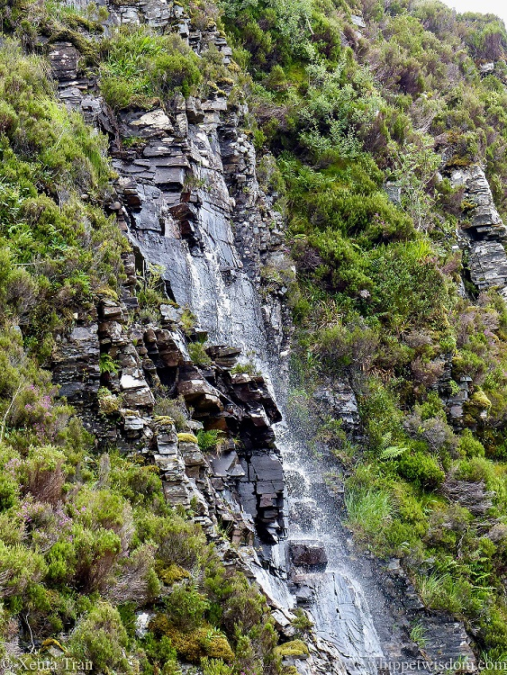 water cascading down the side of Knockan Crag